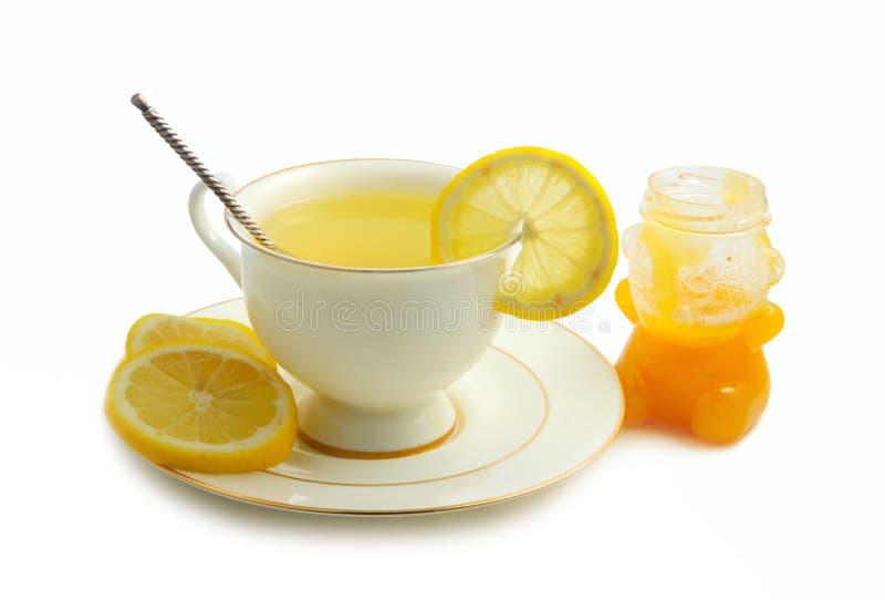 Té verde con el limón y la miel imagenes de archivo