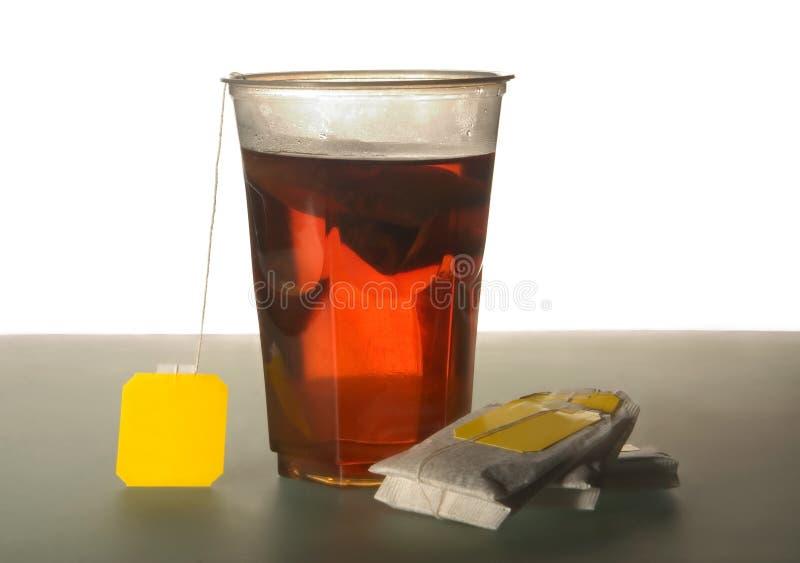 Té y bolsitas de té imagen de archivo