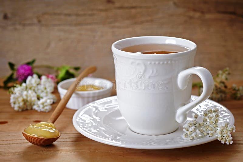 Té y miel foto de archivo