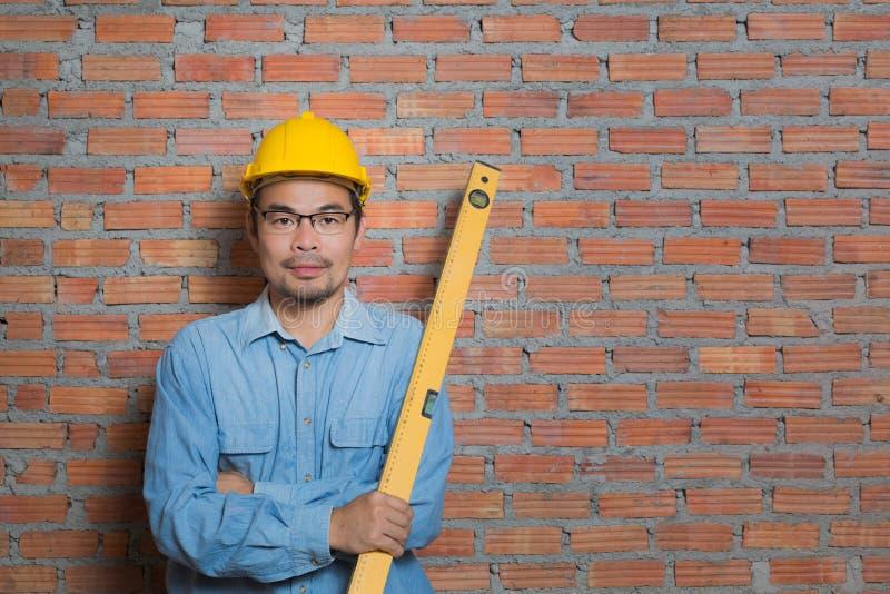 Técnico asiático de la construcción fotografía de archivo