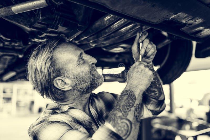 Técnico Concept do mecânico de loja da reparação de automóveis imagens de stock