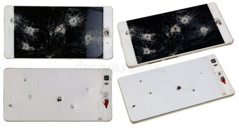 Téléphone avec des trous des clous et des balles photo stock