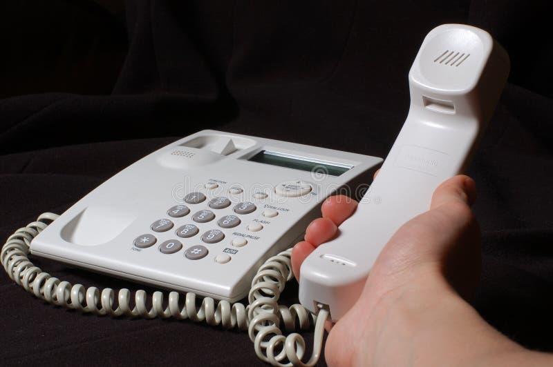 Téléphone blanc d'affaires à disposition photos stock