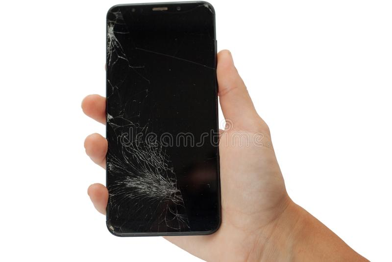 Téléphone cassé noir à disposition sur l'isolat criqué d'écran d'écran tactile de fond blanc photo libre de droits