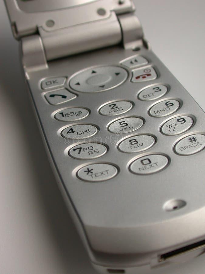 Téléphone cellulaire argenté de chiquenaude photos libres de droits