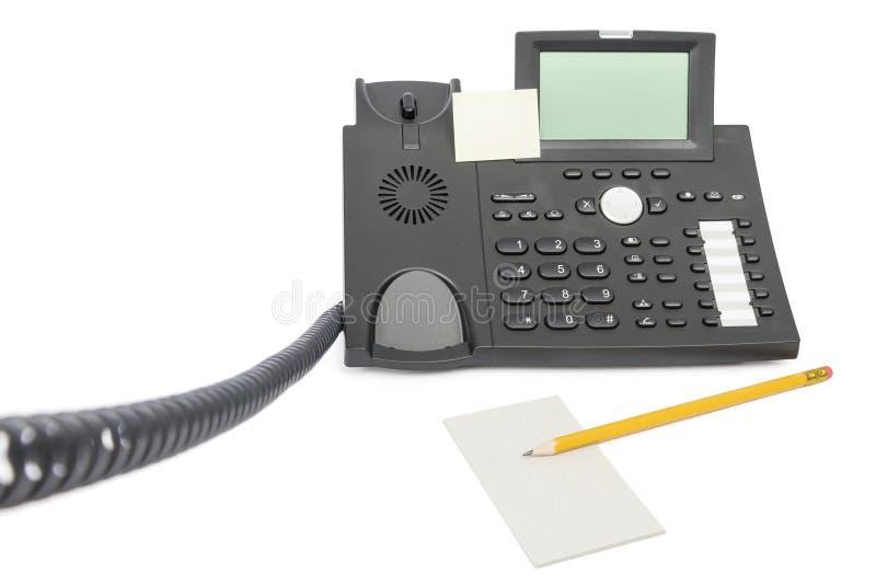 Téléphone d'affaires avec la note et le crayon photo libre de droits