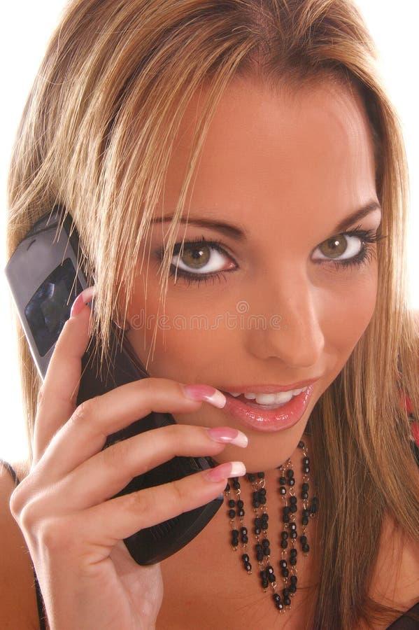 Téléphone d'appareil-photo de fille de charme image libre de droits