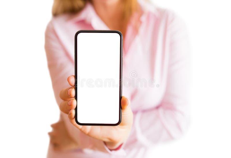 Téléphone d'apparence de femme avec l'écran blanc vide Maquette mobile d'APP photo libre de droits