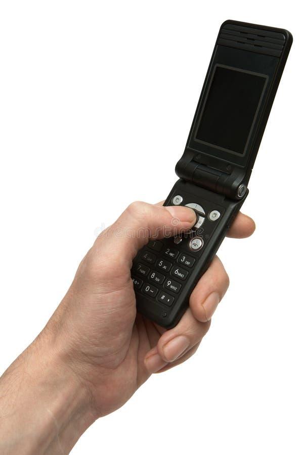 Téléphone dans une main images stock