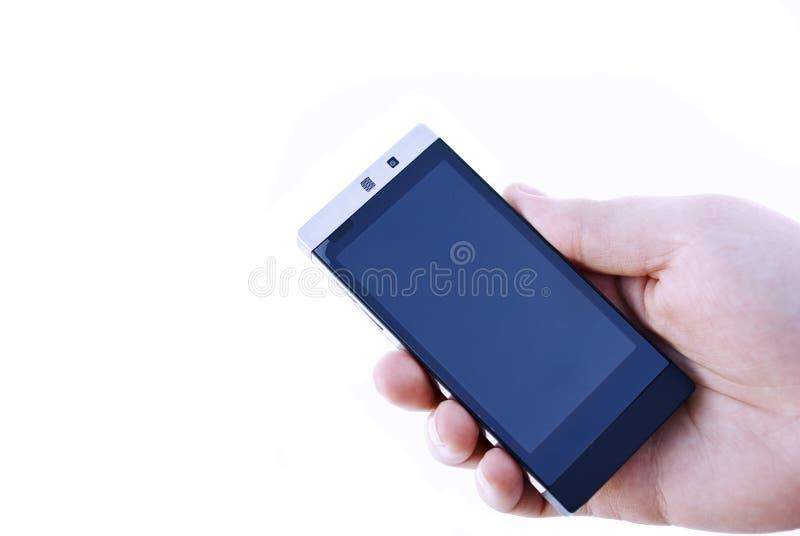 Téléphone de fixation de main photographie stock libre de droits
