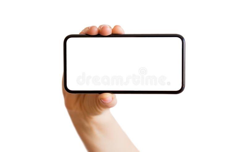 Téléphone de participation de personne avec l'écran blanc vide horizontalement photo stock