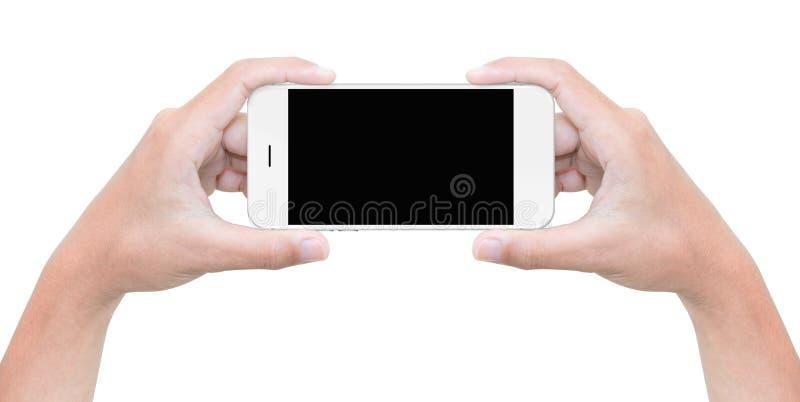 Téléphone de prise de main d'isolement sur le blanc avec le chemin de coupure photos stock
