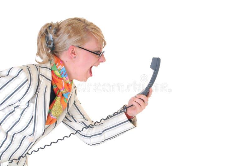 téléphone fâché de femme d'affaires photos stock
