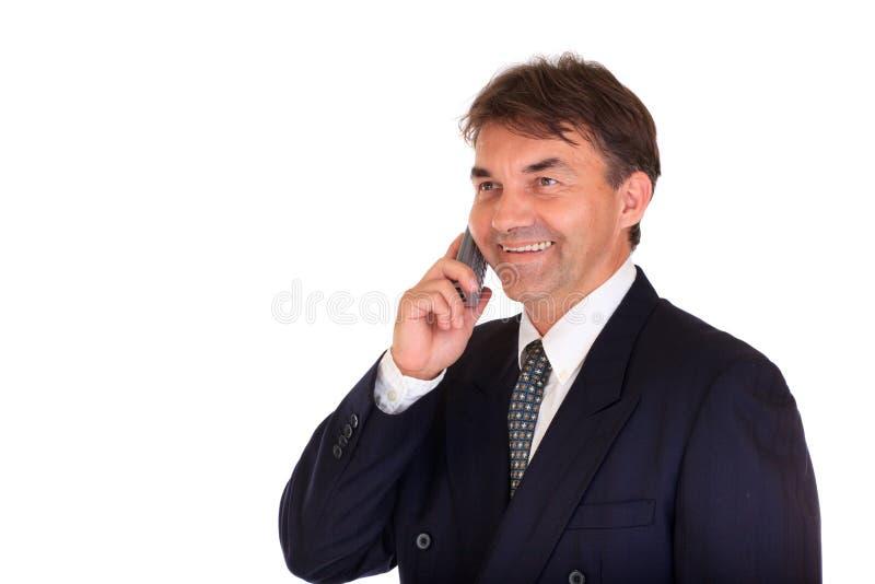 téléphone heureux d'homme d'affaires image libre de droits