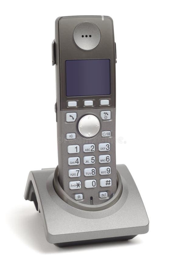 Téléphone neuf dans le berceau images libres de droits