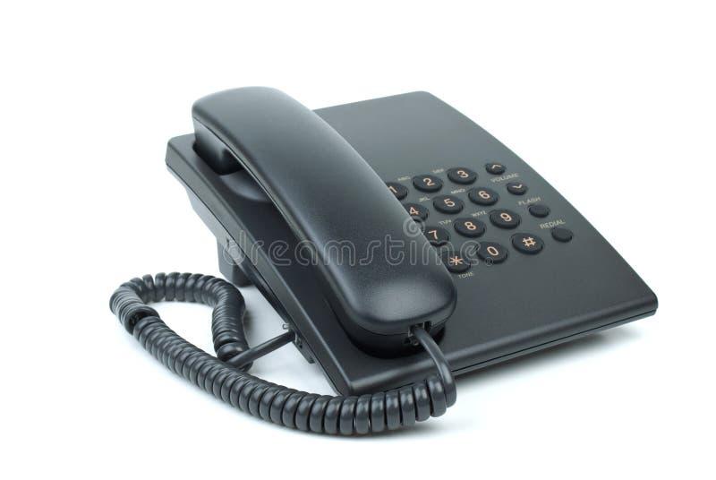 Téléphone noir de bureau avec le combiné téléphonique avec combiné raccroché images libres de droits