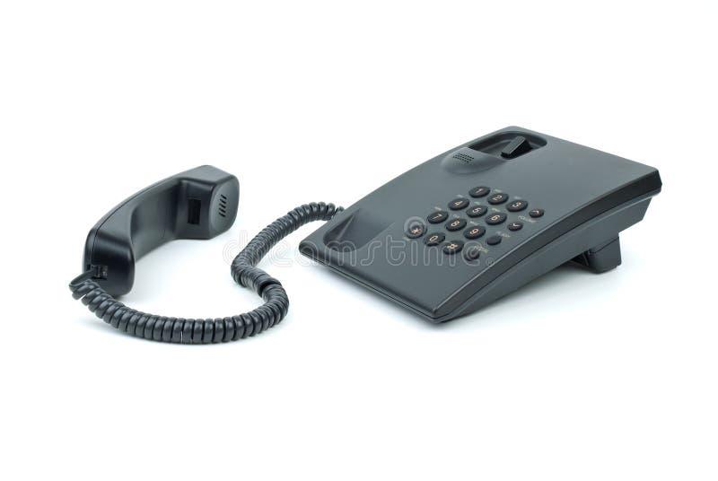 Téléphone noir de bureau avec le combiné téléphonique près photos stock