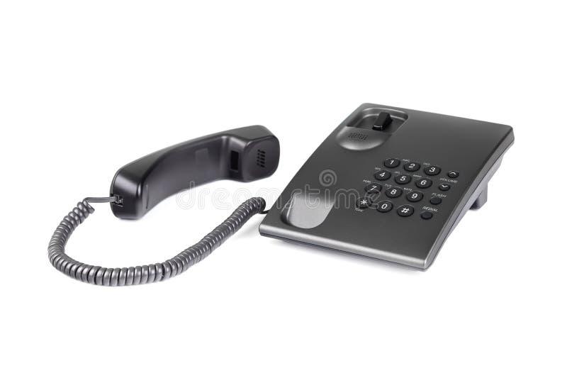 Téléphone noir de bureau avec les boutons arrondis Plan rapproché photos libres de droits