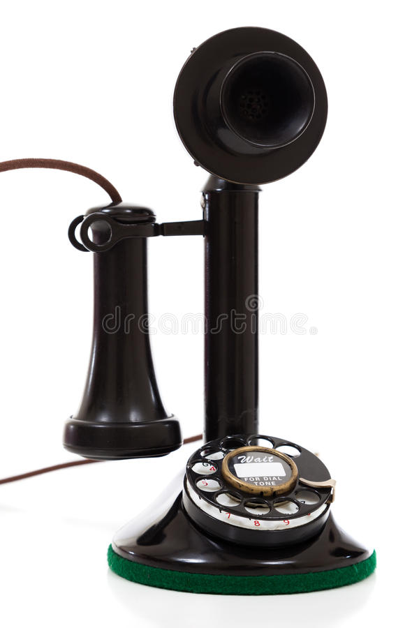 Téléphone noir de chandelier sur un fond blanc photographie stock