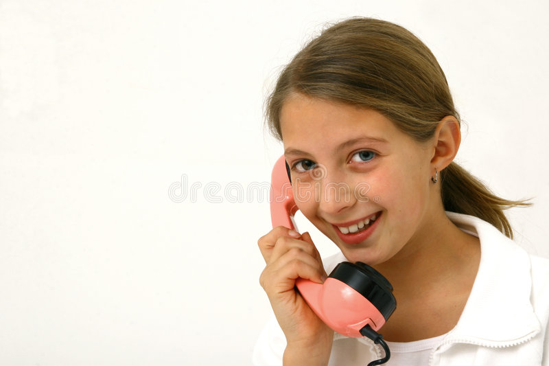 Téléphone parlant de fille photo stock
