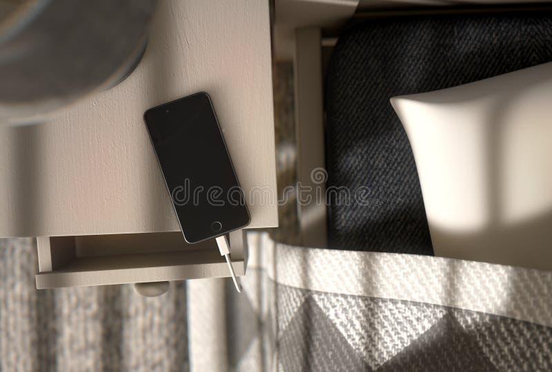 Téléphone portable à côté du lit photographie stock libre de droits