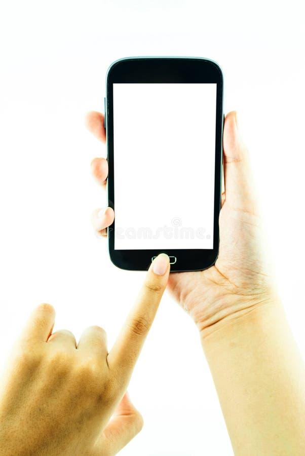 Téléphone portable avec l'écran tactile dans la main femelle sur le fond blanc images stock