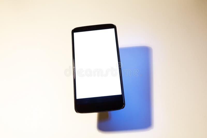 Téléphone portable avec l'ombre photo libre de droits