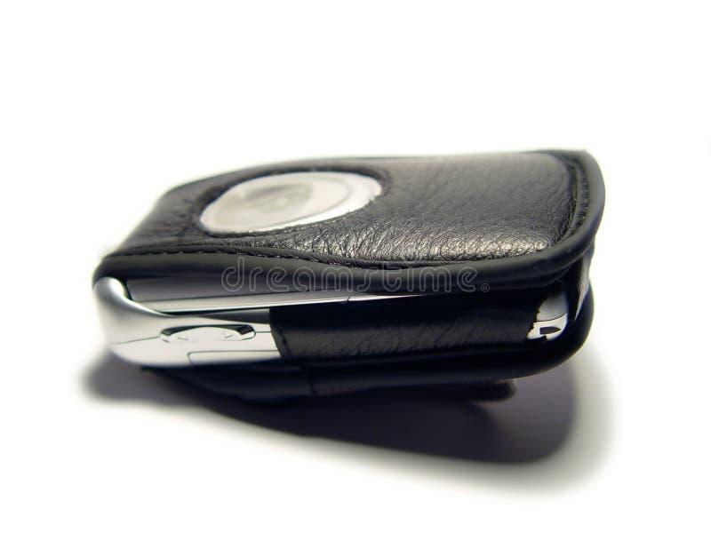 Téléphone portable avec la valise fermée images libres de droits