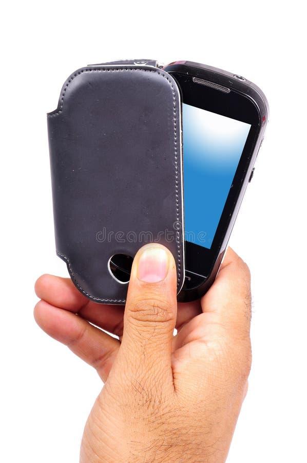 Téléphone portable avec le cache photos stock