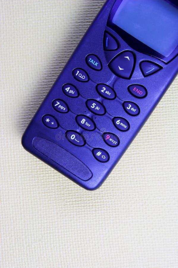 Téléphone portable bleu photographie stock