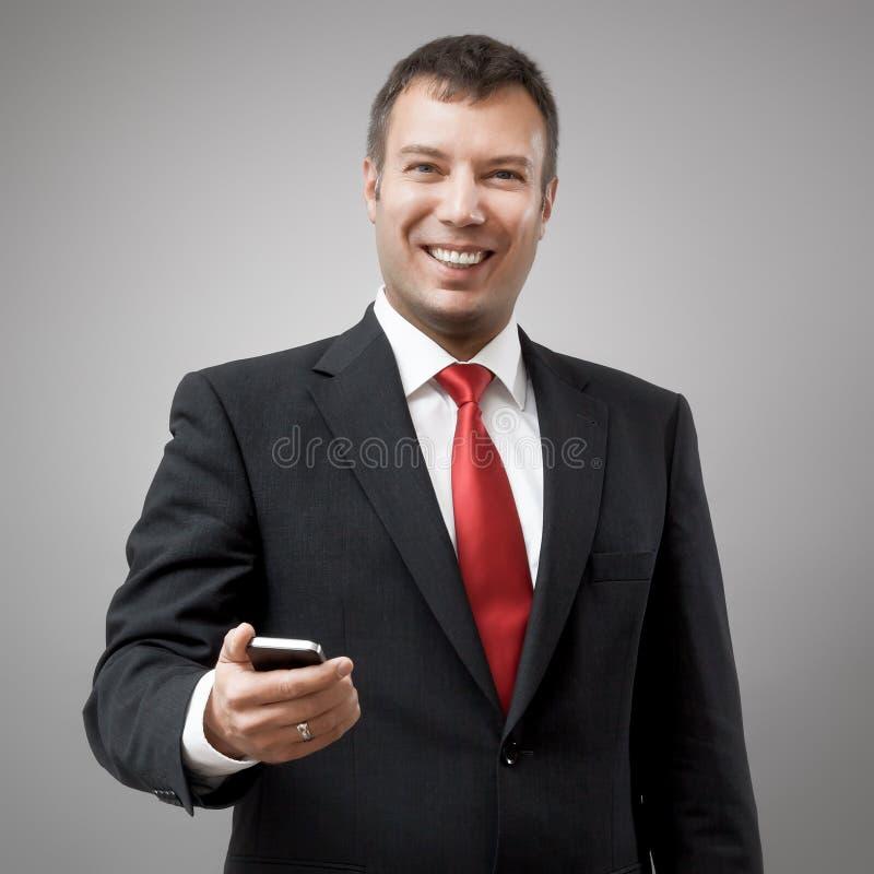 Téléphone portable d'homme d'affaires images libres de droits