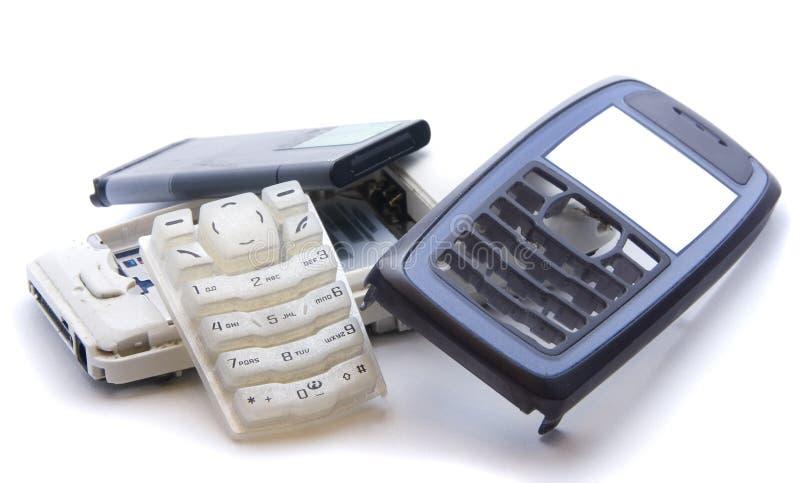 Téléphone portable dans les pièces photographie stock libre de droits