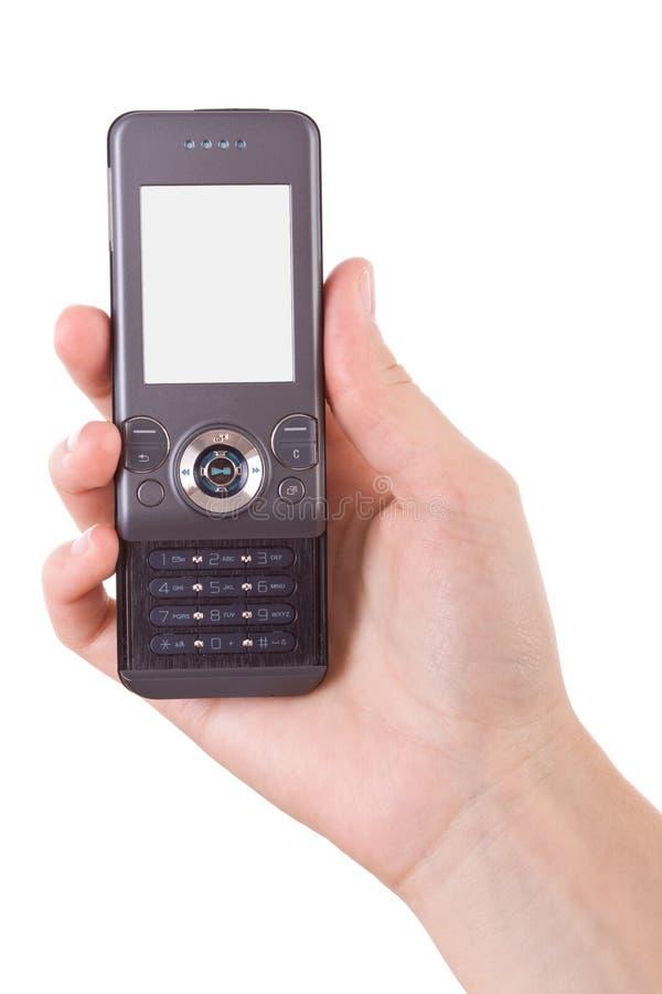 téléphone portable de fixation de main photographie stock