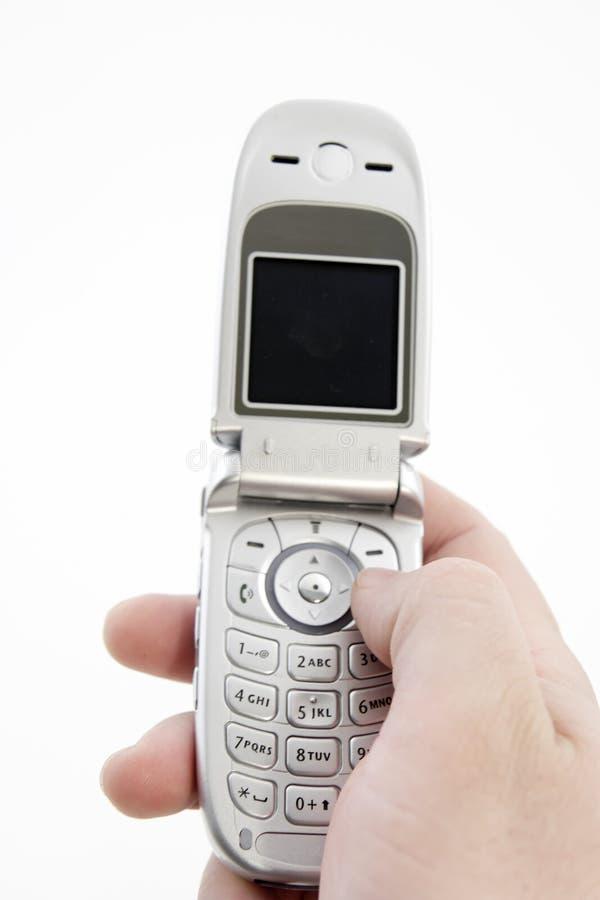 Téléphone portable de fixation de main avec le chemin de découpage photographie stock libre de droits