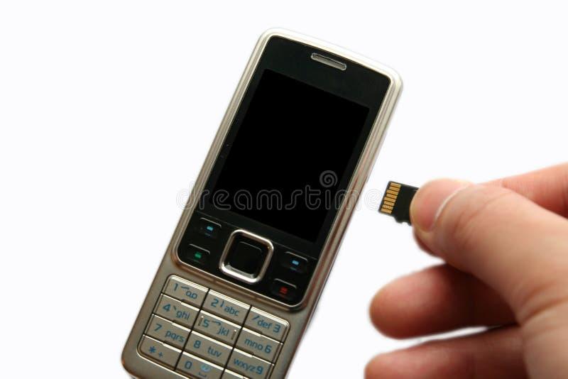 téléphone portable de mémoire de main de carte photographie stock libre de droits