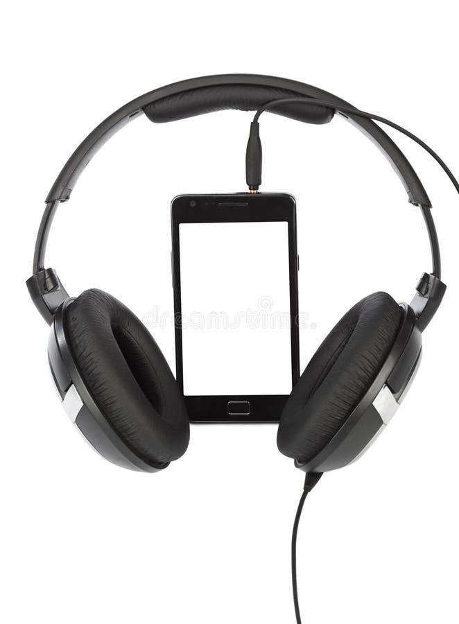 Téléphone portable et écouteurs image stock