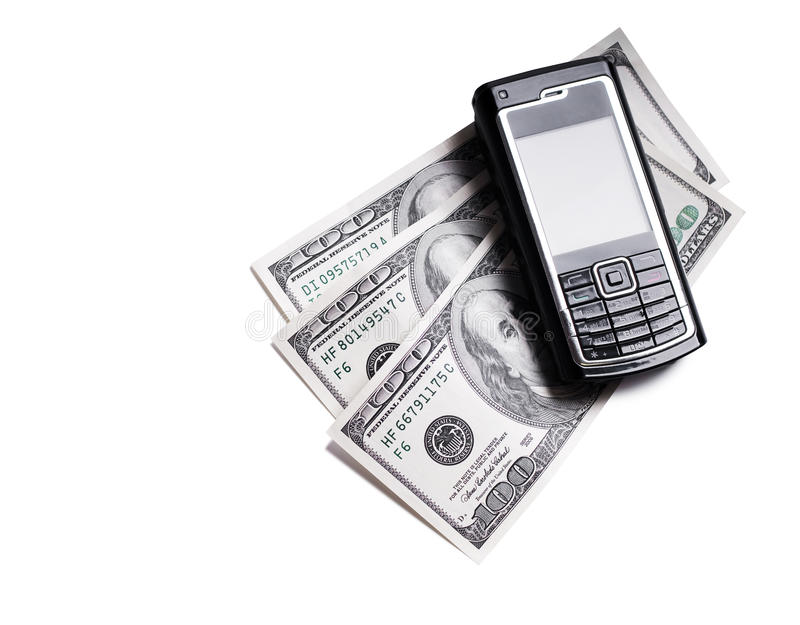Téléphone portable et dollars photographie stock libre de droits