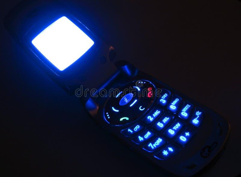 Téléphone portable rougeoyant photographie stock