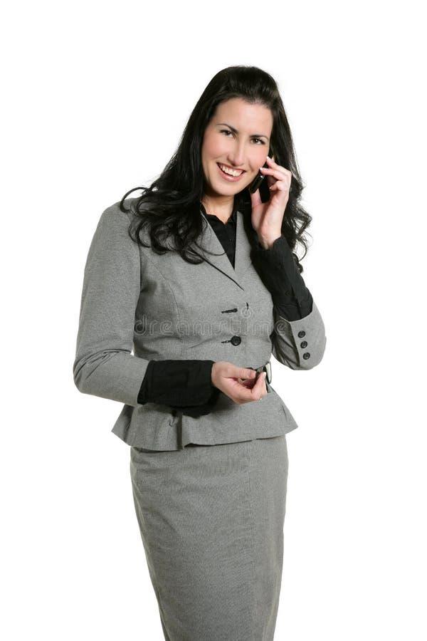 Téléphone portable talling de femme d'affaires de Brunette photographie stock libre de droits