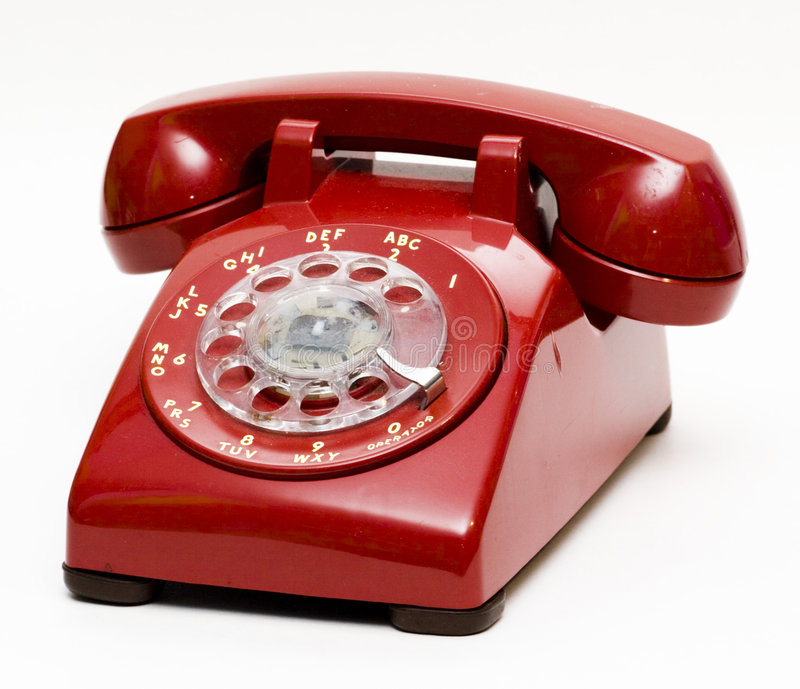 Téléphone rotatoire rouge antique images libres de droits