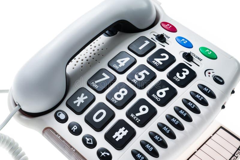 Téléphone stationnaire pour les personnes âgées photographie stock