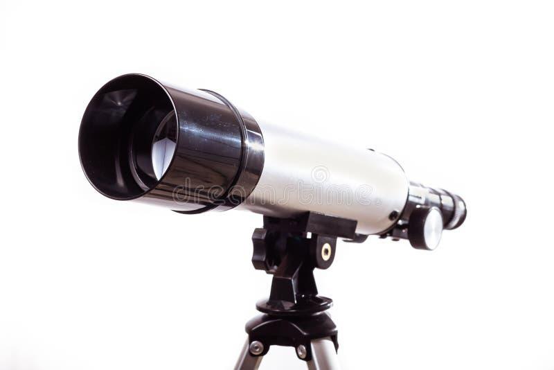 Télescope sur fond blanc posé sur une planche en bois images stock