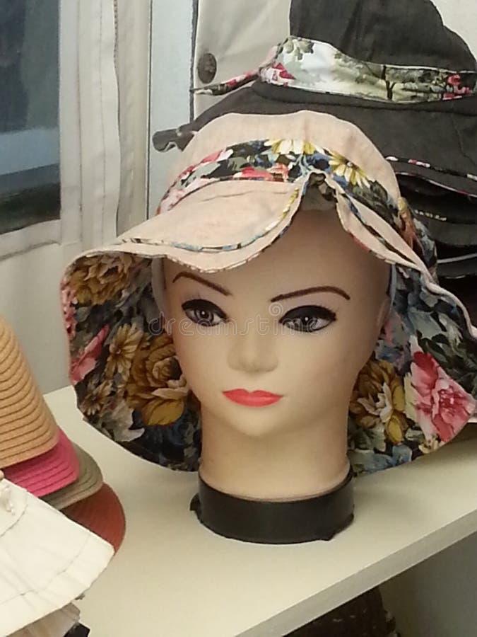 Tête avec le chapeau photographie stock