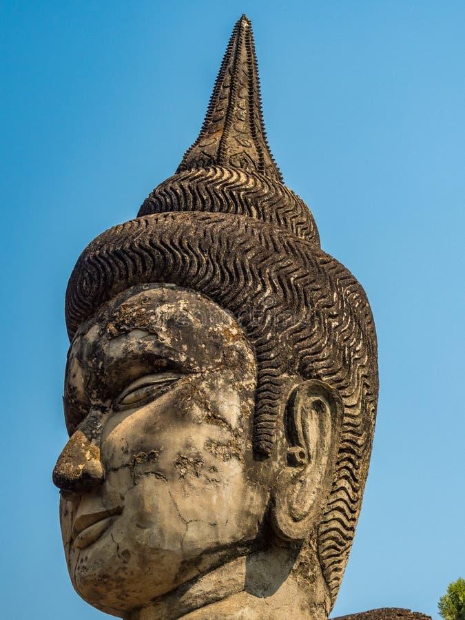 Tête de Bouddha de géant, Xieng Khuan Près de Vientiane, le Laos photographie stock