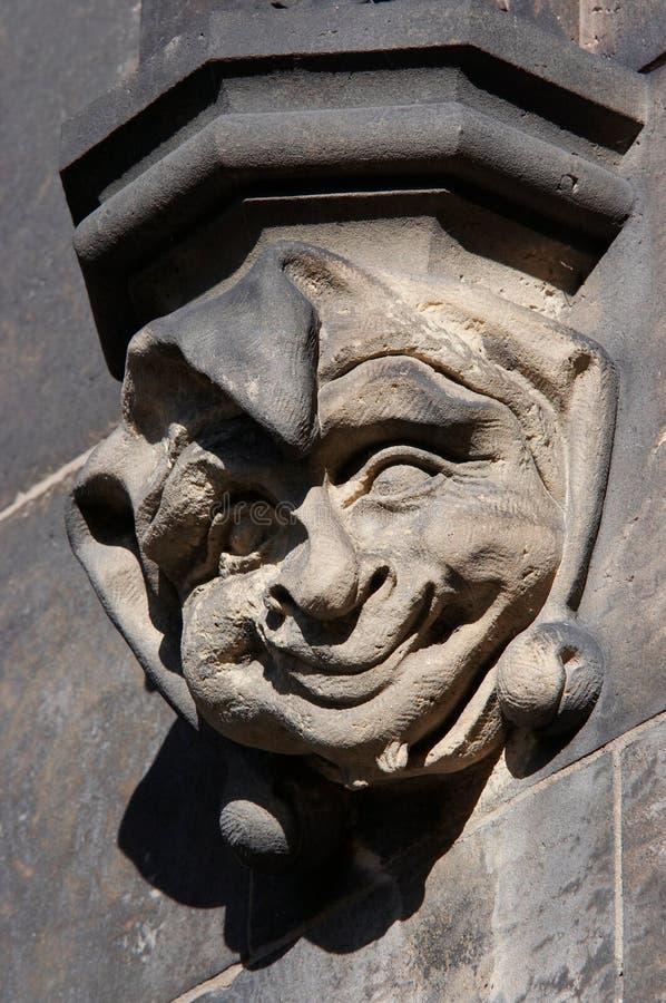 Tête en pierre gothique du clown photos libres de droits