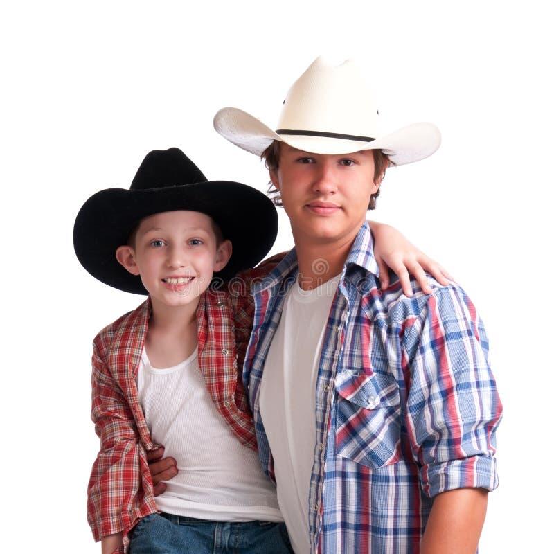 Tío y sobrino del vaquero imagen de archivo