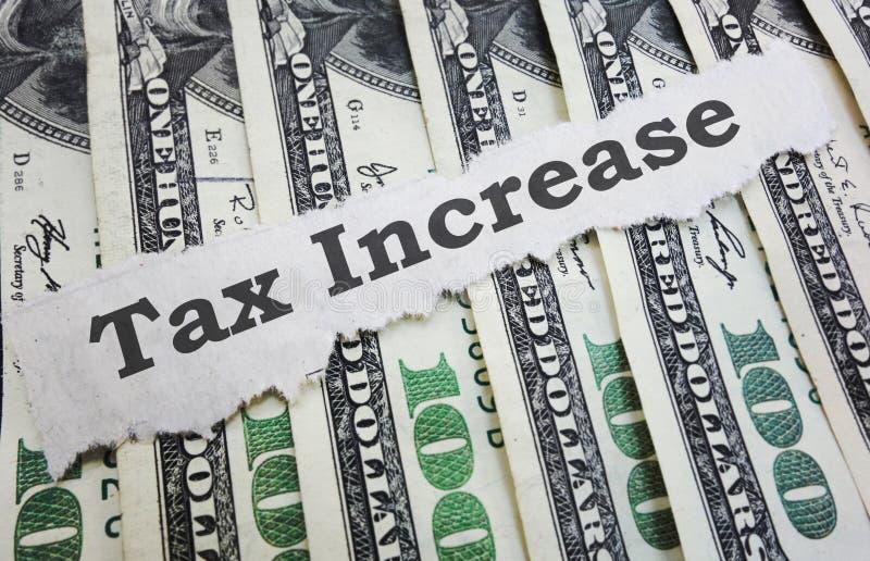 Título de las noticias del aumento del impuesto fotografía de archivo libre de regalías