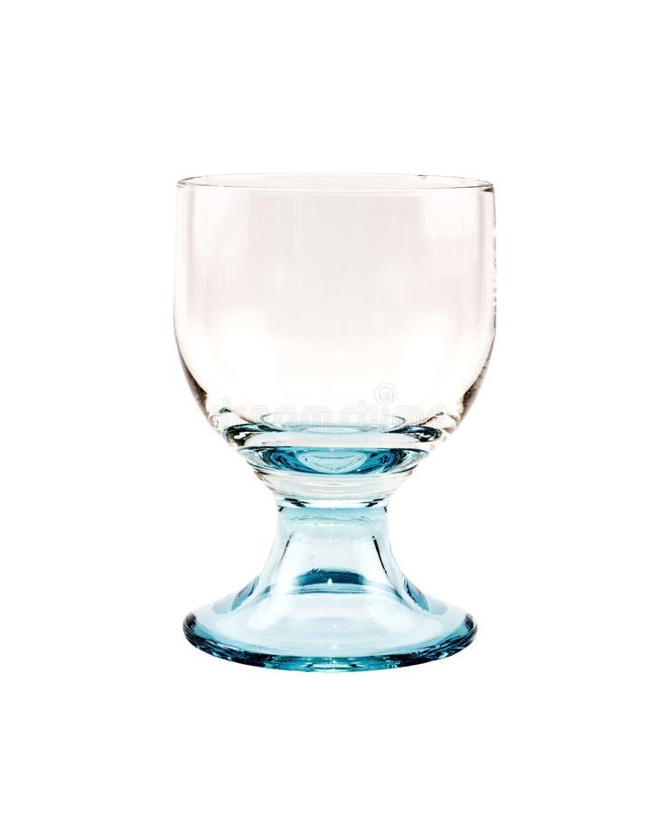Töm genomskinligt exponeringsglas för coctailar på en vit bakgrund arkivbilder
