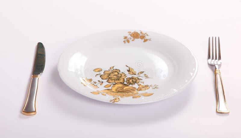 Töm maträtten med gaffeln och baktala royaltyfria foton
