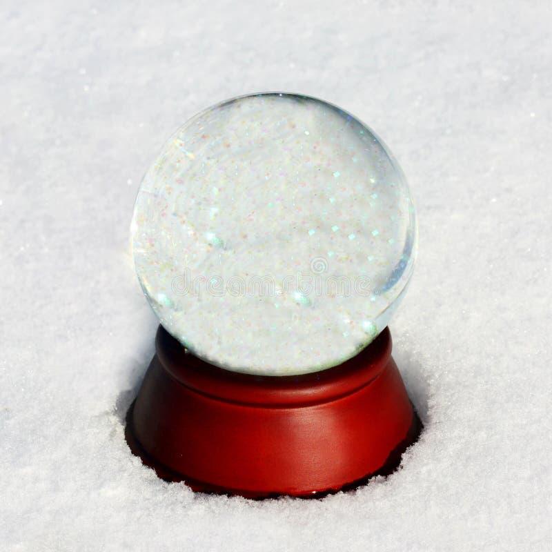 Töm snöjordklotet med Copyspace arkivfoton